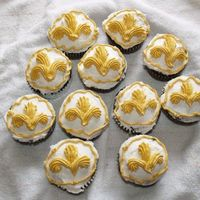 Fleur De Lis Cupcakes  I made these cupcakes with a few cupcakes I had leftover from another project. I used a tip 21 to make the Fleur de Lis. Thanks for looking...