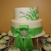 Bridal Shower Cake   Butter cream with fondant acents and matching cupcakes :-)