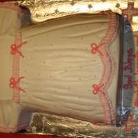 Dress Cake   All made out of buttercream :-) Except the pearls and lil flowers, these are fondant.