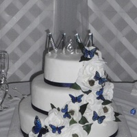 Monica 16/12/8 covered in fondant. Silk ribbon and gardenias with butterflies