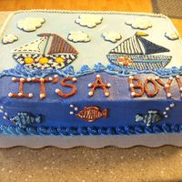 Sailboat Baby Shower This cake was made for a baby shower with a sailboat theme. The baby bedding was provided to me for ideas on how to decorate.