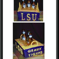 Lsu Michelob Ultra Sugar Bottle Cake   Had a little trouble with leveling. Yellow cake with buttercream icing and satin ice decor
