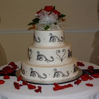 Wedding Cake- Blk & Wht Buttercream frosting with royal icing scroll work. The pearls are fondant.