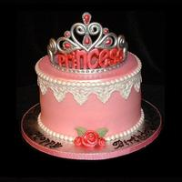 Princess Tiara Cake This is a carrot cake iced with crusting cream cheese frosting and decorated with fondant pearls, lace and ribbon roses.