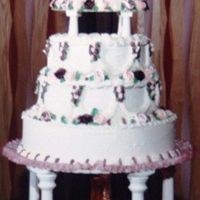 My Wedding Cake 1990 All BC with BC roses, fountain and silk flowers. Made by my aunt, which made my wedding day very special. Sorry for the poor quality of the...
