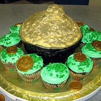 Pot O' Gold Cake With Field Of Shamrock Cupcakes A pot o' gold (made from the Wilton Giant Cupcake pan) surrounded by a field of mint chocolate cupcakes. I used edible glitter to make...