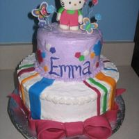 Emma's Hello Kitty Kitty. bow, flowers and butterflies are all made with rolled buttercream fondant. Frosted in buttercream.