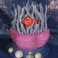 Nemo In The Anenome This was a butter yellow cake, baked in a stainless steel mixing bowl then sculpted. Covered in buttercream. The anenome 'tenticles&#...