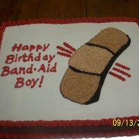 Band Aid  This was for my husband's boss. I guess it's an inside joke. It's a half sheet cake where I used a projector to get the...