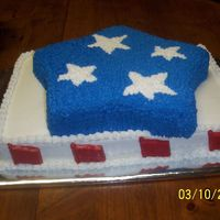 Fourth Of July  This cake was made to welcome home a friend from Iraq. It was a half sheet cake with a star cake on top. The flags around the sides were...