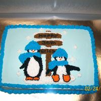 Penguins This was a quarter sheet cake for a friend that is obsessed with penguins.