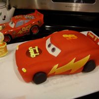 Lightening Mcqueen Thanks to merissa for the tutorial and inspiration. My grandson loved this cake. Sculpted chocolate and raspberry cake layers covered in...