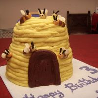 Beehive Cake Beehive cake frosted in honey buttercream (a bit too soft and sticky for nice, neat piping, but it tastes great). Tootsie roll bees. Made...