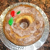 Sour Cream Coffee Cake I made this for my dad's birthday. I thought it looked plain so i made a fondant rose and leaves and painted them with food coloring...