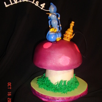 Caterpillar's Mushroom  This is a companion piece to my Cheshire cat I uploaded earlier. The top part is chocolate cake. The stem is RKT covered with white...