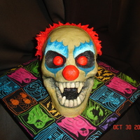 Evil Klown   With the exception of the fangs, this is done entirely with buttercream.