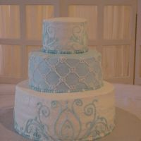 "Blue/white Scroll Wedding Cake The bride wanted me to do a smaller version of Martha Stewart's Wedding Cake. All BC icing using 6"", 10"", and 14"" round..."