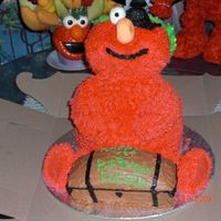 Pirate Elmo This was fun to make. The head, arms and legs are rice krispy treats. I used the wondermold pan on an 8`` round. The treasure chest was the...