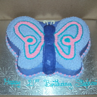 Butterfly white cake with buttercream icing.