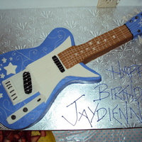 Hannah Montana Guitar the cake wascarved from a 11x15 sheet cake, covered in buttercream with mmf accents