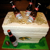 Beer Cooler Cake Styrofoam cooler cake. Was, unfortunately, out of town the week prior so didn't have time to make beer bottle molds for sugar bottles...