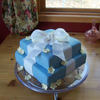 Morgan's Bridal Shower WASC with raspberry filling and MMF. All fondant. I wasn't too happy with this one, There were a ton of flaws! You can't see many...