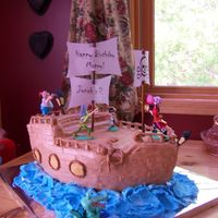 Jonah's Pirate Ship B-Day Cake I did this for my son's 3rd bday. He wanted Peter Pan pirate ship cake. I bought the Peter Pan toys to put on it. WASC MMF. It took me...