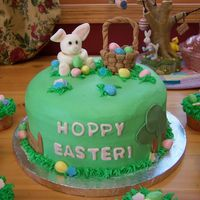 Easter Cake Buttercream with fondant accents. Fondant bunny and basket. Eggs are Reeses peanut butter eggs. I loved making this! Oh, I had some left...