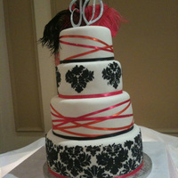 Kim damask stencil and criss crossing ribbon, fondant icing. thanks for looking!