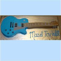 Electric Guitar Cakes I made 2 of these life size guitar cakes & 3 sheet cakes to go with them. They were the biggest cakes I've done yet!! Iced in...