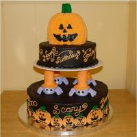 Halloween 1St Birthday Cake This was made for my friend's son's 1st birthday. The top jack o lantern was done to look more like a baby with the tiny teeth &...