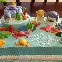 Payton's 4Th Birthday Cake My son requested a Shark Tales cake. I didn't really want to make a shark cake, so I just made an under the sea cake and stuck Oscar &...
