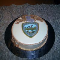 Department Of Wildlife And Fisheries Chocolate cake with cream cheese icing, and edible image. Fondant accessories.