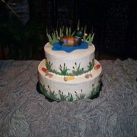 Duck Hunting Duck is rice crispies covered in fondant, and hand painted. chocolate and butter pecan cake with cream cheese icing. Fondant accessories.