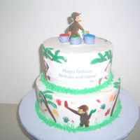 Curious George made this a couple of months ago for a set of twins. Boy and girl! I painted the cake with gel paste colors mixed wtih americolor white....