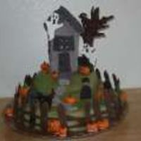 Haunted House Cake  Made this cake for a cake walk at my daughters school. You can't really see it but there is a battery operated tea light inside the...