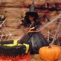 Witch And Cauldron  Wonder mold doll pan covered in black candy melts. Cauldron is also the wonder mold, carved and covered in black candy melts. Pumpkin is a...