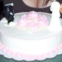 My Divorce Cake i had a divorce party and i decided to make a cake for it. i bought a cheap little cake topper and stuck the groom's head in it. i got...