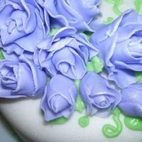 Closer Pic Of Fondant Roses   just wanted yall to see the pretty pearl dust on my roses! im pretty proud of my cake. lol