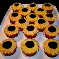 Sunflower Cuppies  I think I looked at every sunflower cuppy on CC to get ideas for these! Lemon cake with buttercream petals and fondant centers (molded but...