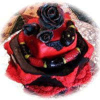 Gothic Birhtday Cake For A Snake Lover!   Strawberry mini cake with gummie snake and fondant /gumpaste decorations.