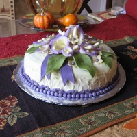 "Calla Lilly Birthday Cake   ""8 dome, white chocolate/almond cake with almond frosting. Fondant flowers/leaves."