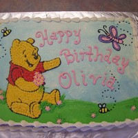 Winnie The Pooh This is a 1/2 sheet iced and decorated with buttercream.