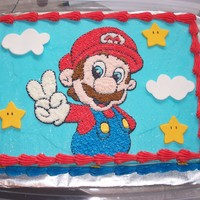 Super Mario This is a 1/4 sheet cake iced with buttercream. The stars and clouds are fondant.