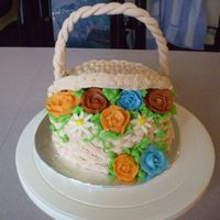 "Basket Cake Inspiration came from the many cakes here on CC. Made for a very special friend for her birthday, 6"" inche vanilla cake iced in..."