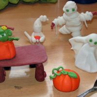 Halloween Figures Ghost, Mummie, Frankenstein out of pumpkin and Pumpkin from fondant/ gumpaste. Also made a table for putting little things on.The little...