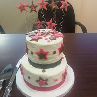 Pink And Brown Stars  White on bottom, chocolate on top, buttercream with fondant stars. Pixie dust on stars. I had issues w/smoothing, but I was kinda in a...