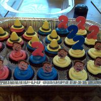 Curious George Cupcakes  Inspired by cupcakes by joey2jack on here. Chocolate with MMF decorations affixed to lollipop stix with Royal Icing. Matching cake in my...