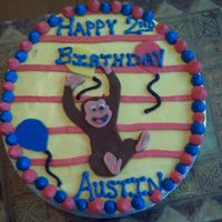 Curious George   Chocolate cake with buttercream. MMF George and Balloons. This was a blast to make. Matching cupcakes in my pictures.