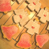 Angels And Bells Basic sugar cookie decorated with royal icing and sanding sugar.